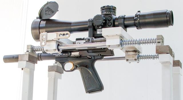 Buckmark pistol with suppressor in test stand